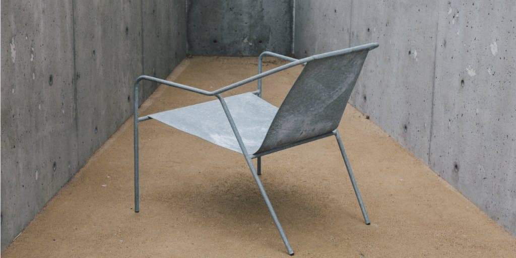 metal chair in an enclosed room, trapped