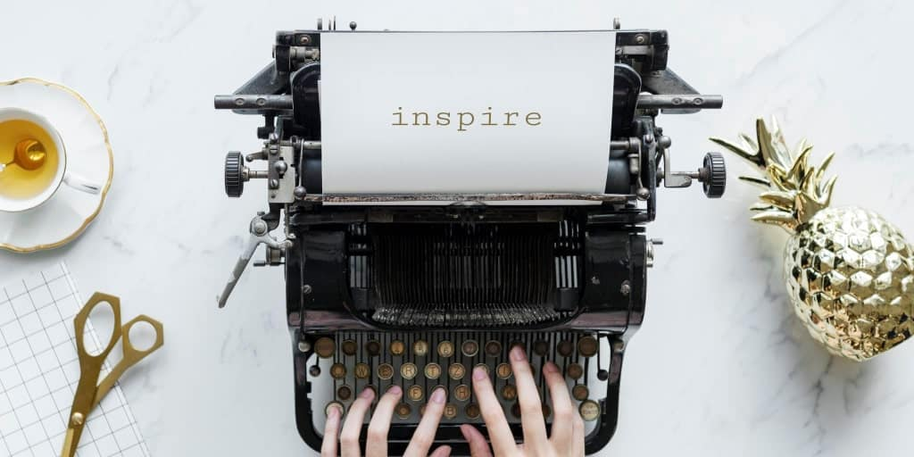 the word inspire typed on a typewriter