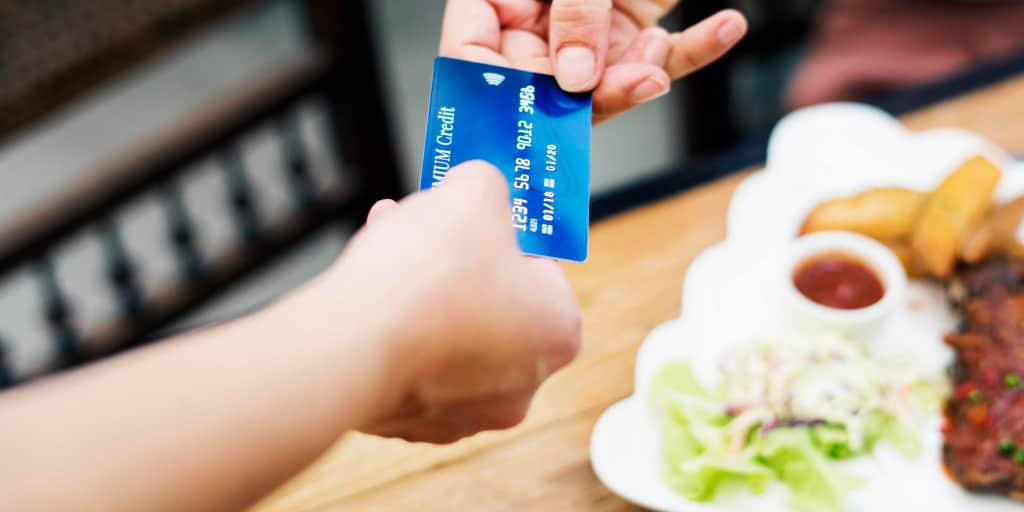 credit card being used to pay for a lunch