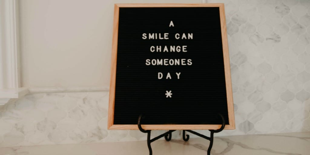 a smile can change someones day sign