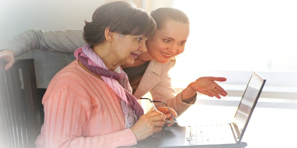 woman helping mother with looking up her credit